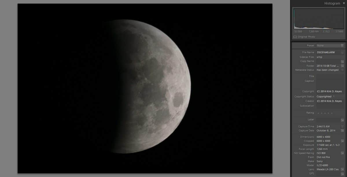 """The Moon is about half covered by the umbra during the eclipse on October 8th, 2014. This photo was taken using a Sony a6000 APS-C camera connected to an 8"""" f/10 Meade LX-200 Classic with a 0.63 Focal Reducer. This combination produces a lens that is 1260 mm at f/6.3. ISO was 800 and the shutter speed was 1/1600 second. Photo Credit: ©2019 Kirk D. Keyes"""