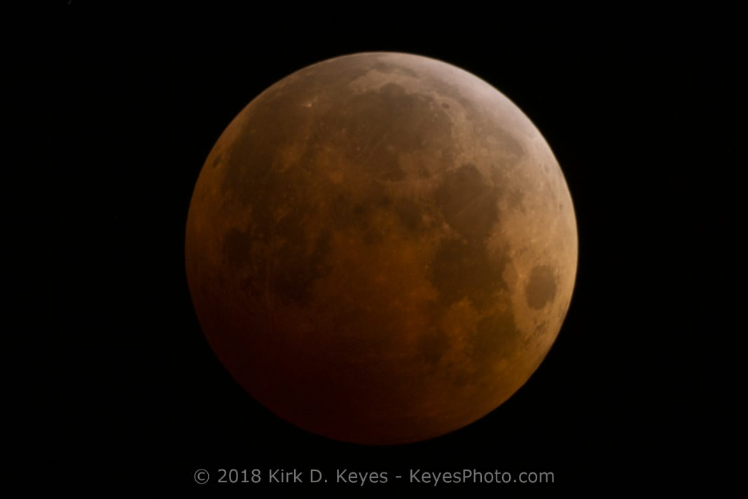 How to Photograph the Total Lunar Eclipse - A Total Lunar Eclipse of the Moon. Photographed on 9 October 2014 with a 1260mm lens. Photo Credit: ©2018 Kirk D. Keyes