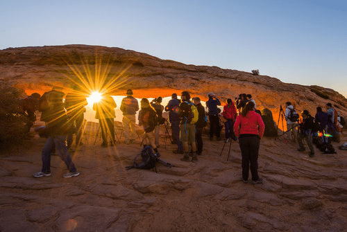 NatureFirstPhotography.org A mass of humanity overruns Mesa Arch for the sunrise.