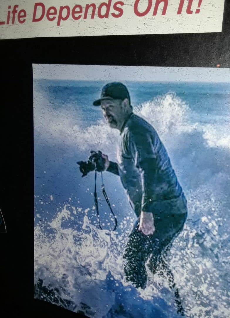 This photographer looks a little worried as he's caught in the surf at Thor's Well. Photographer Unknown. Photograph posted outside the Luna Sea Restaurant in Yachats, OR.