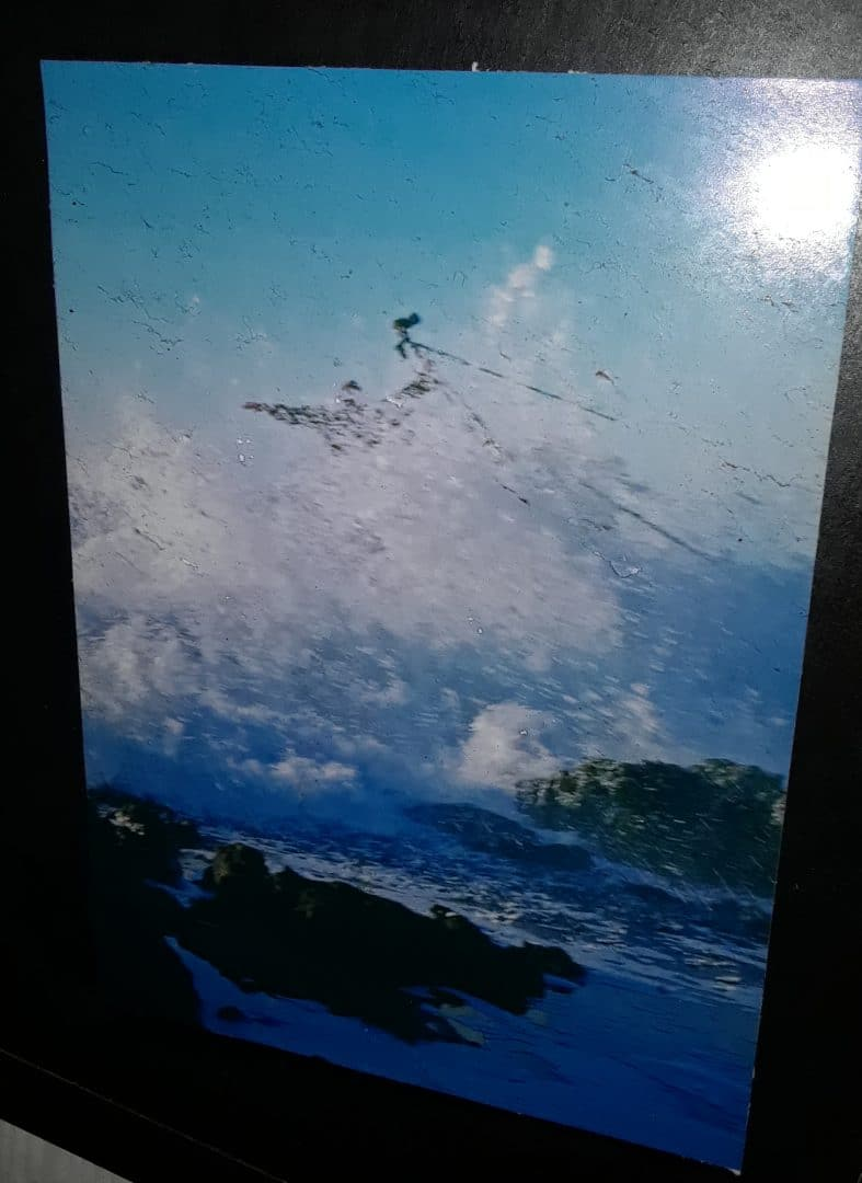 An unlucky photographer is swallowed by the surf at Thor's Well. Photographer Unknown. Photograph posted outside the Luna Sea Restaurant in Yachats, OR.