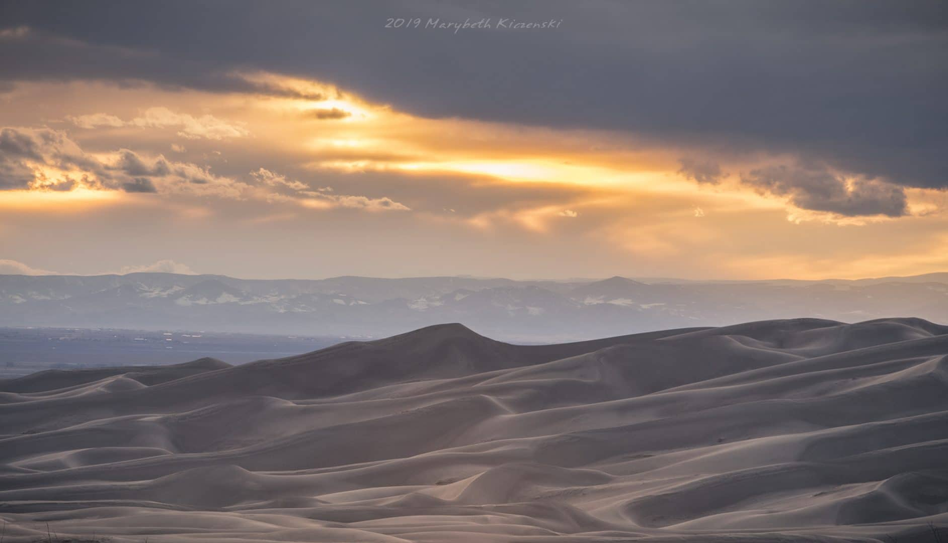 2019 Copyright MaryBeth Kiczenski. A cloudy sunset over the dune field.