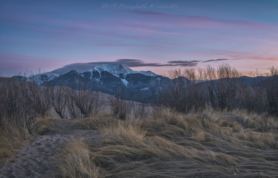 2019 Copyright MaryBeth Kiczenski. Pastel pinks paint the landscape as the sun begins to rise.