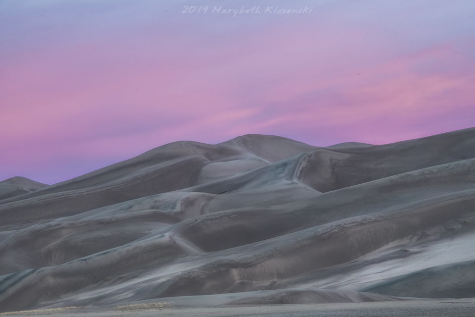 2019 Copyright MaryBeth Kiczenski. There's always something magical about sand dunes against a pink sky!