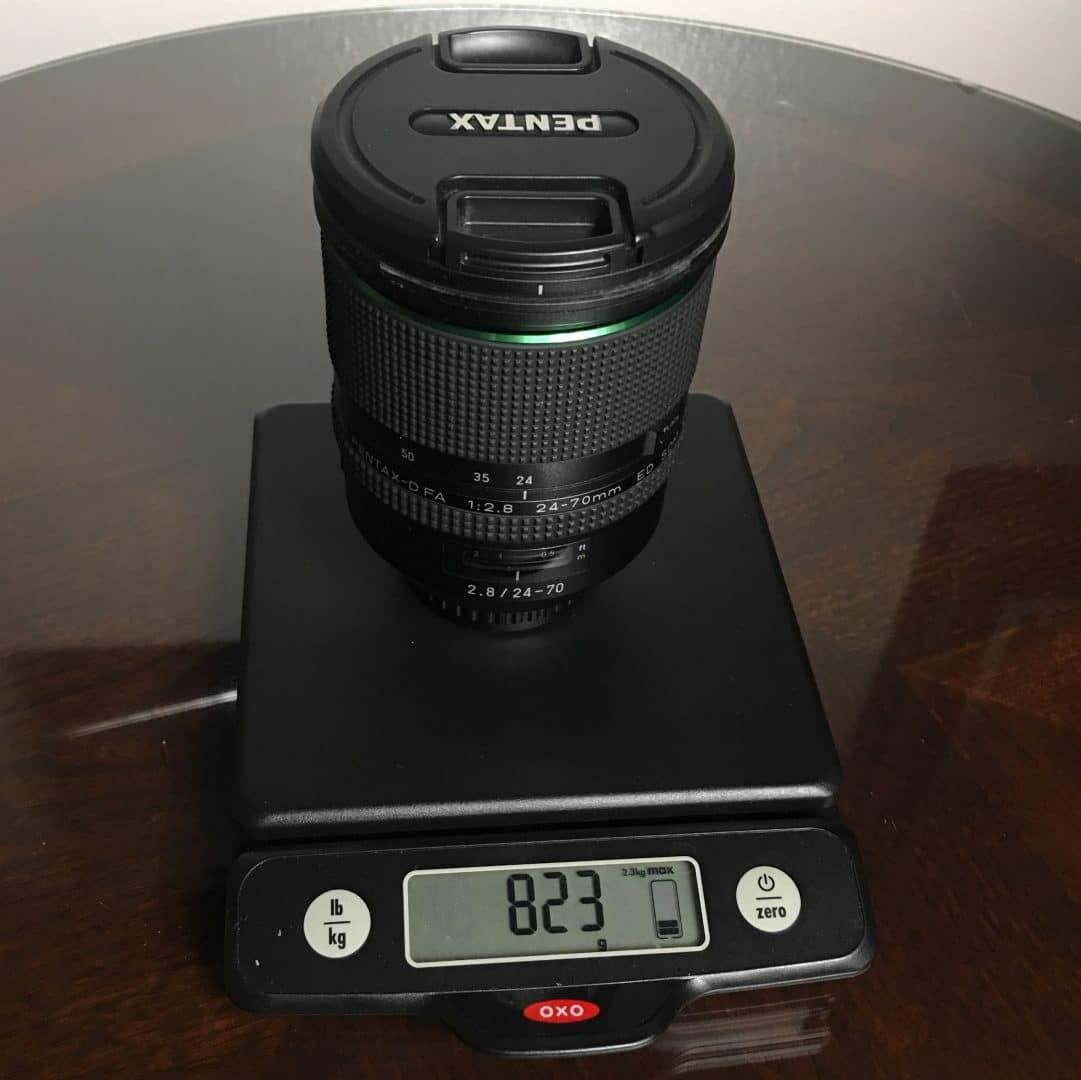 Pentax 24-70mm f/2.8 weighs 823 grams. Prime or Zoom?