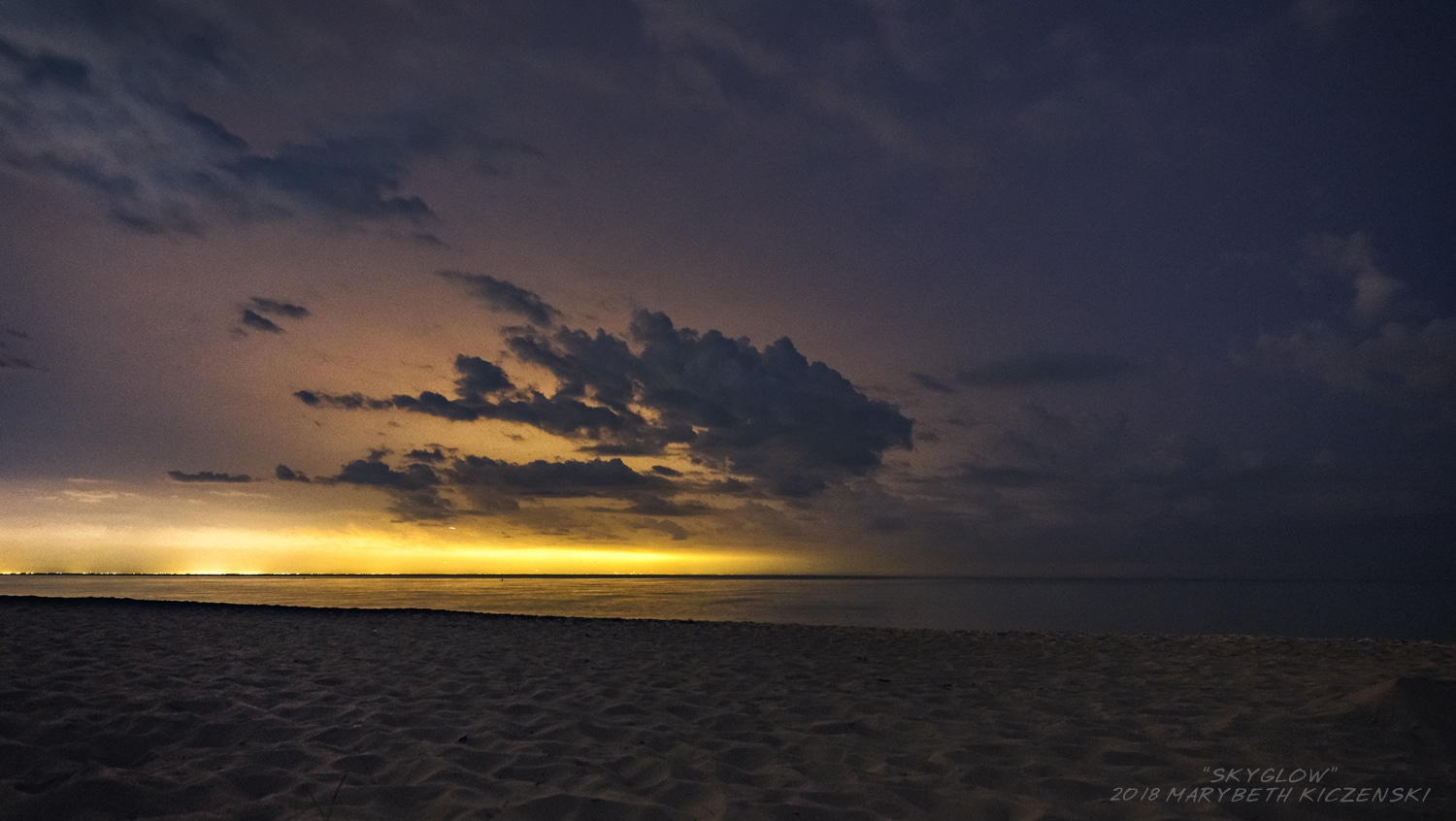 """Nope, that is not a sunset!  That is Chicago's Skyglow as seem from Indiana Dunes National Park.  From MilkyWayPhotographers.com, """"Top Milky Way Photography Tricks That Aren't Tricks!"""" Photo Credit: MaryBeth Kiczenski"""