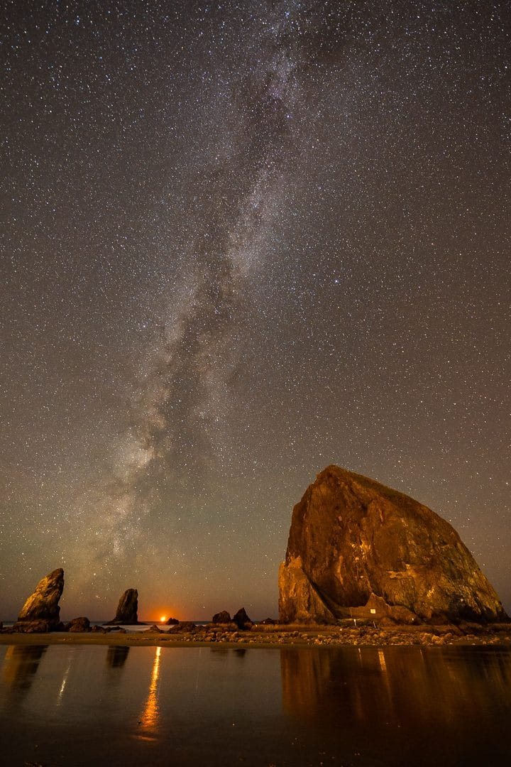 A setting crescent Moon sets behind Haystack Rock as the Milky Way looms overhead. This image was taken mid-October after the Milky Way core has set. Favorite Milky Way Photography Locations Photography by Kirk D. Keyes.