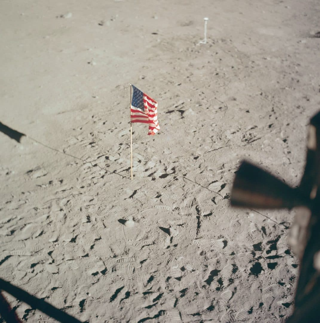 Who owns the bootprints around the United States flag on Tranquility Base? Taken from inside the Lunar Module. Photo Courtesy of NASA. Who owns the Moon prints?