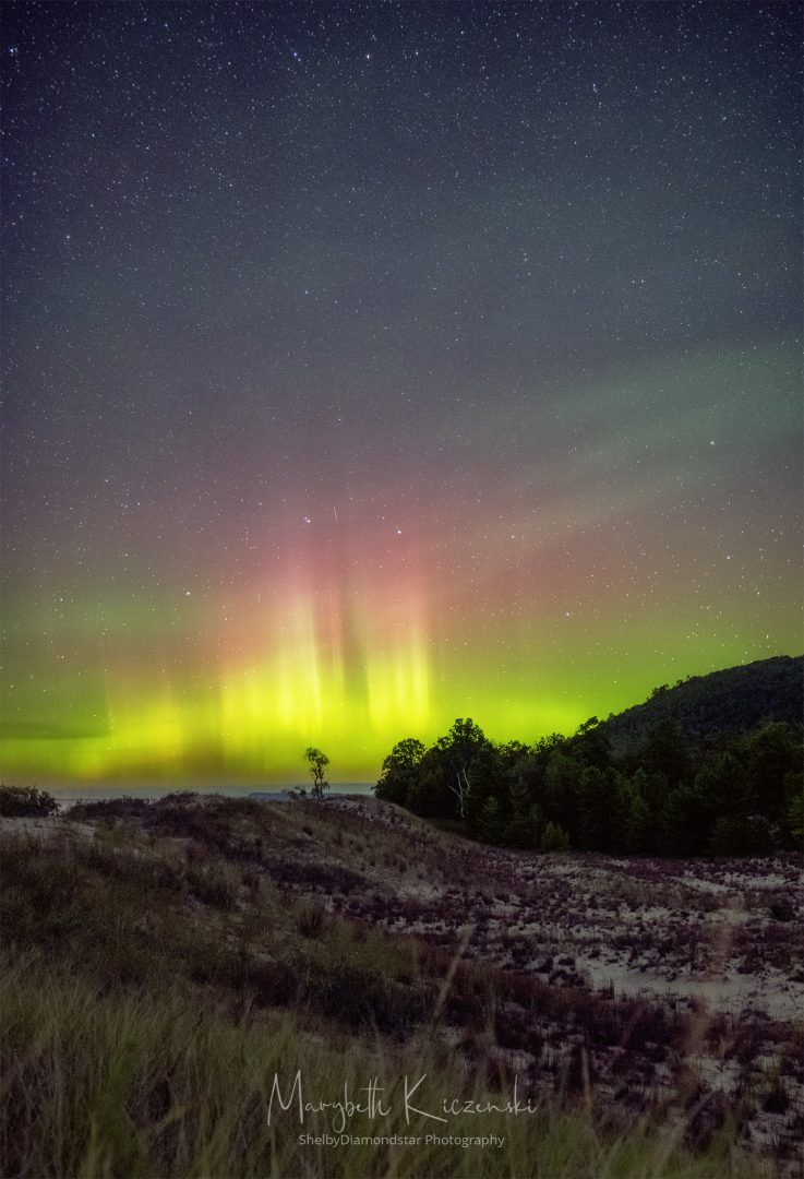Labor Day Aurora 2019 - Auroral pillars shining bright over the sand dunes. Photo by MaryBeth Kiczenski.