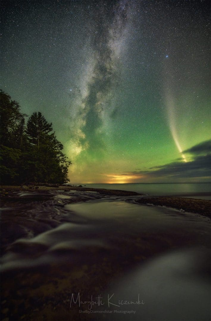 2019 Labor Day Aurora and STEVE. A portrait orientation photo of the Milky Way and STEVE, taken after the image above.  A bit more of the green airglow in this one.  (Nikon Z6 - 14-24mm)  Notice how much the STEVE has changed. Photo by MaryBeth Kiczenski.