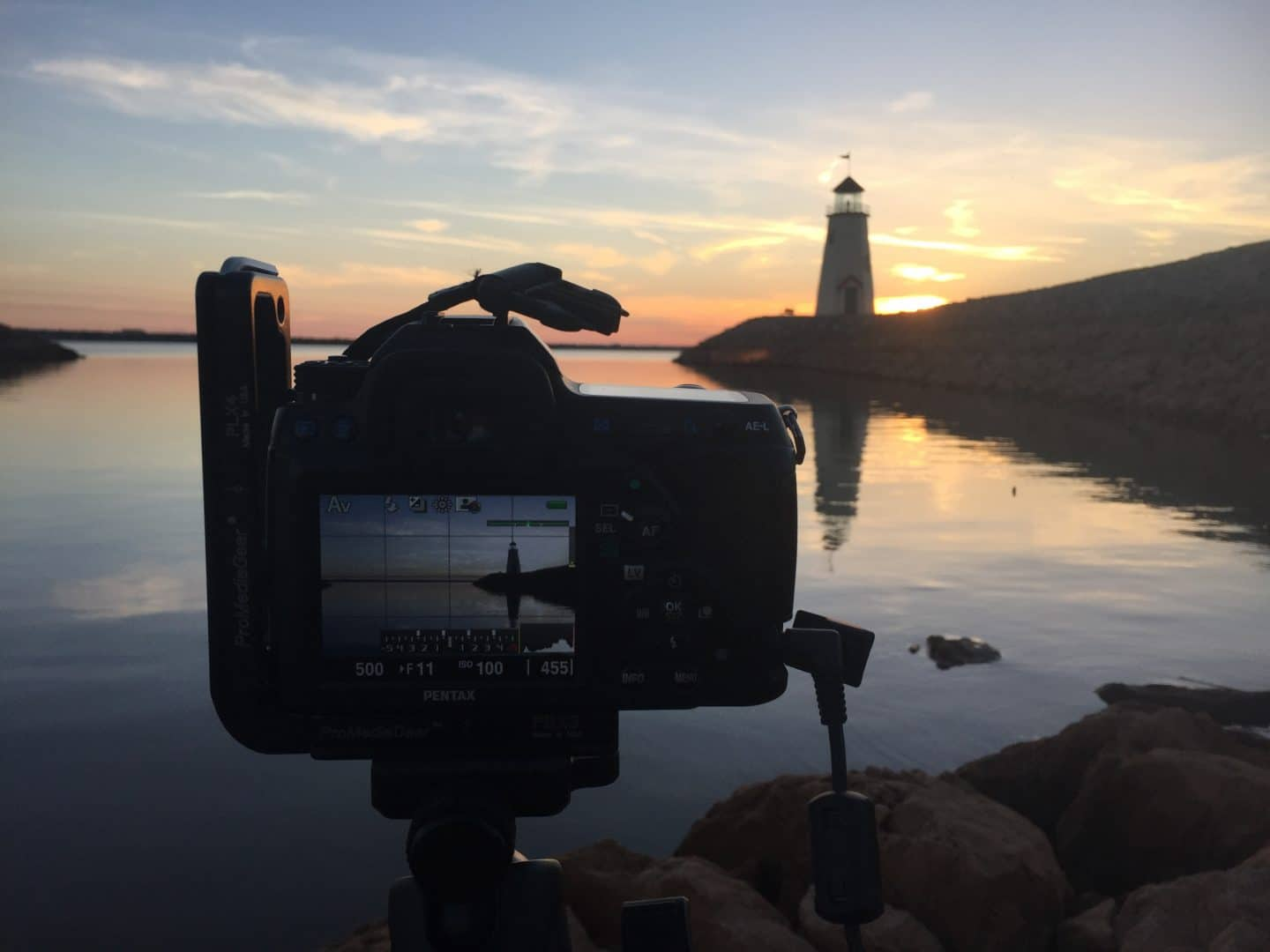 """The Pentax K-5 II did good by me and our adventures. Here we were catching sunset at Lake Hefner, Oklahoma. Yes, you read that right, there is a lighthouse in Oklahoma. From """"Switching Camera Brands"""" Copyright 2020 Stanly Harper"""