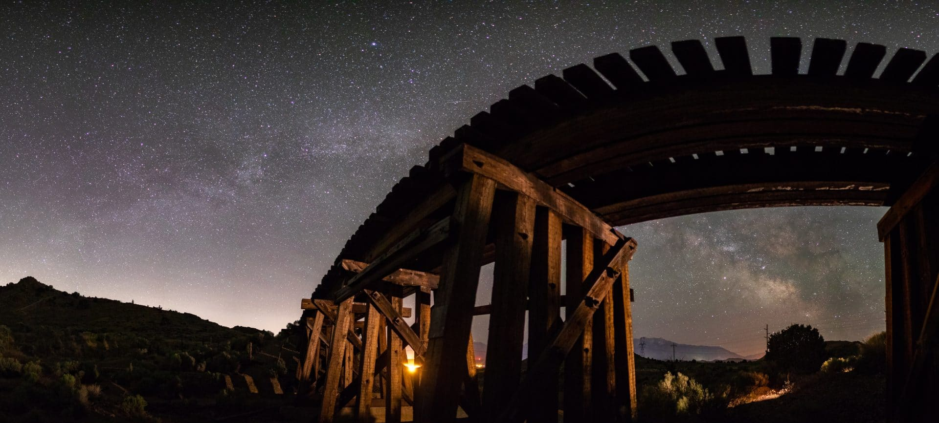 Milky Way getting framed by an abandoned train trestle. The panorama is created very close to the trestle causing extreme distortion and bending of the straight trestle and forcing a cool shape from top to bottom.