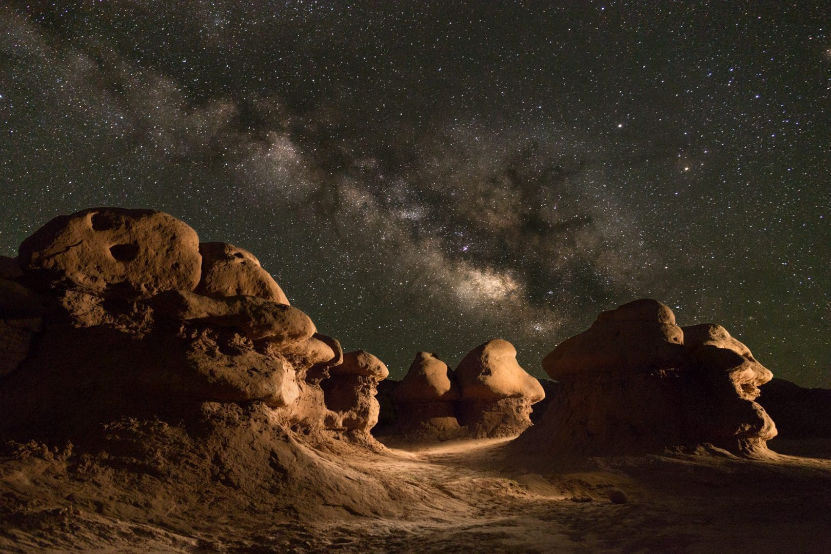 Milky Way over some hoodoos at Goblin Valley. The framing of the largest and weightiest rocks on the left complement the Galactic core on the right.