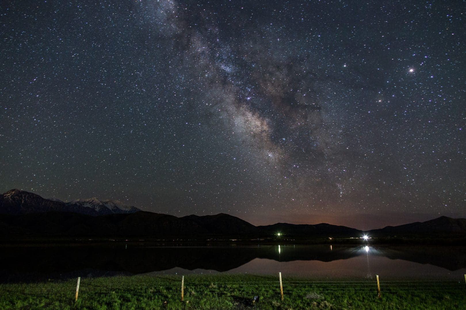 Boring Milky Way composition over some water and distant mountains with nothing of interest in the foreground.
