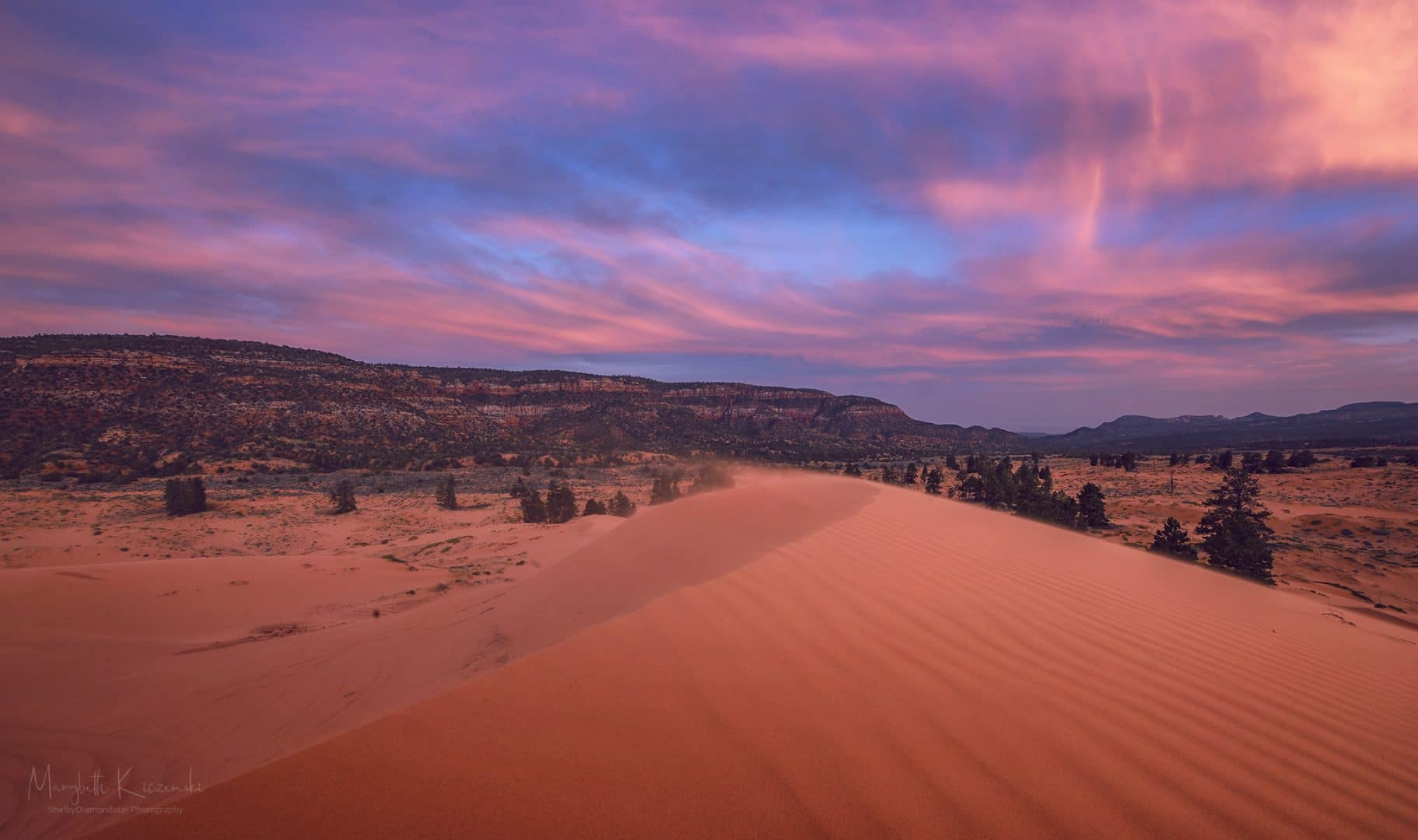 "The ""coral pink"" in the sand dunes start to show as the sun sinks below the horizon. Copyright 2020 MaryBeth Kiczenski."