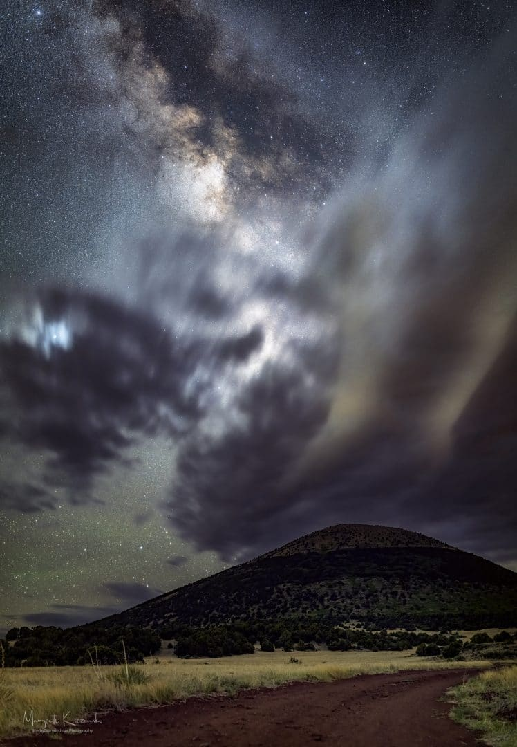 Capulin Volcano with storm clouds. 35mm Panorama.  Nikon D850 - Sigma ART 35mm. Tracked/Untracked. Copyright 2020 MaryBeth Kiczenski.