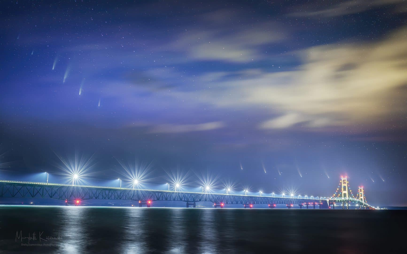 Deepscape astrophotography at Mackinac Bridge and Comet NEOWISE - a time-blended image showing the motion of Comet NEOWISE through the night sky.