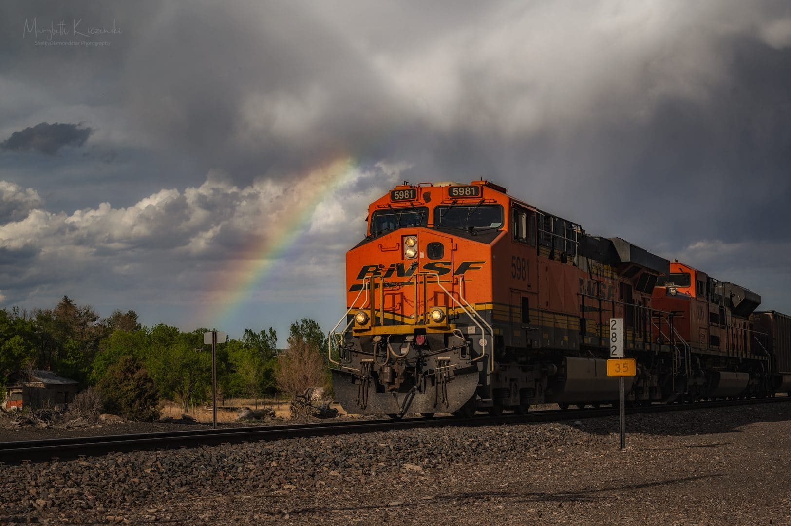 "Didn't know ""train with rainbow"" (trainbow?) was on my bucket list of shots, but here we are!   Nikon D850 - Nikkor 70-200mm. Copyright 2020 MaryBeth Kiczenski."