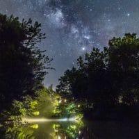 Cabin lights under the Milky Way